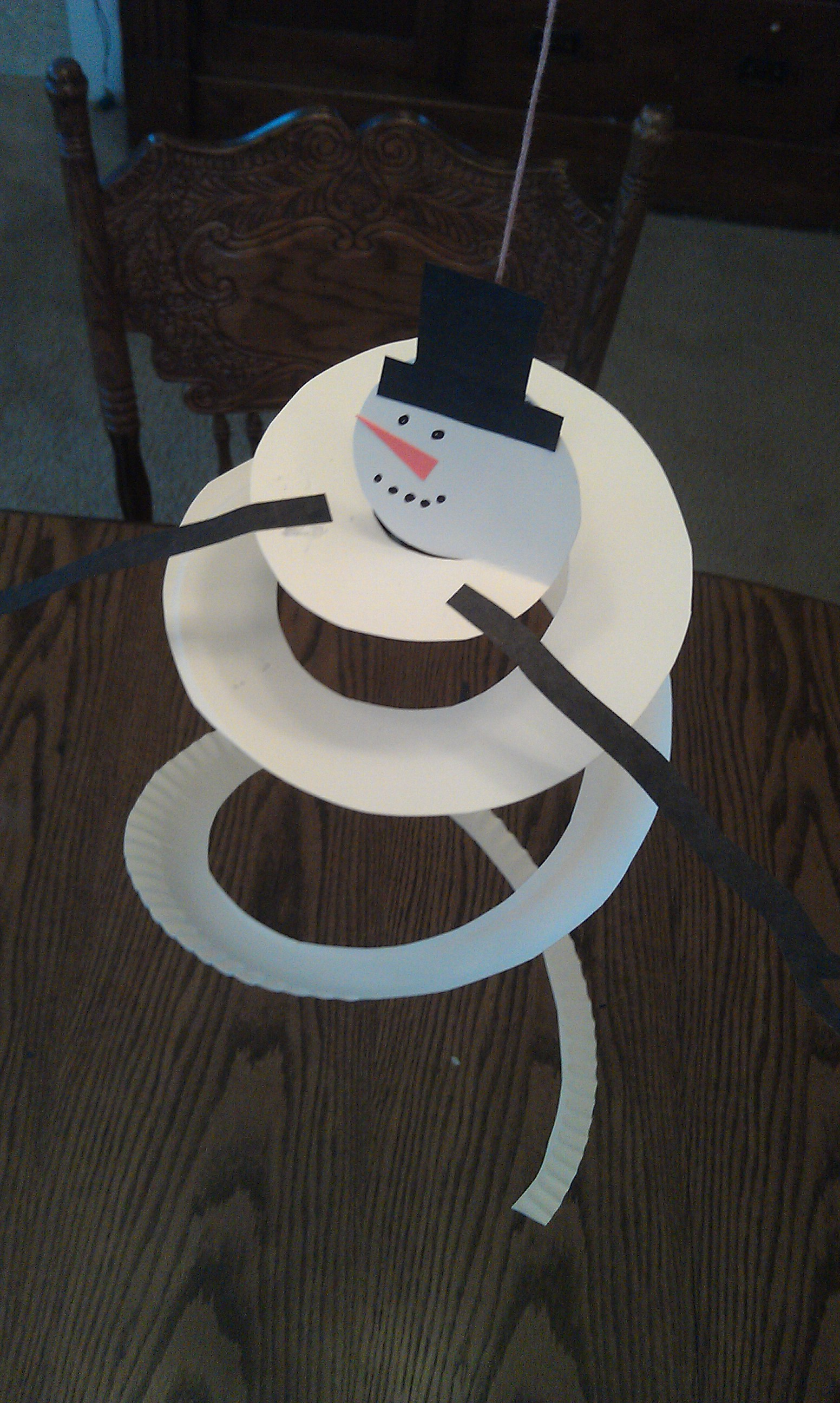 Cut a spiral out of your paper plate. & Snowman Mobile Craft from a Paper Plate | Woo! Jr. Kids Activities