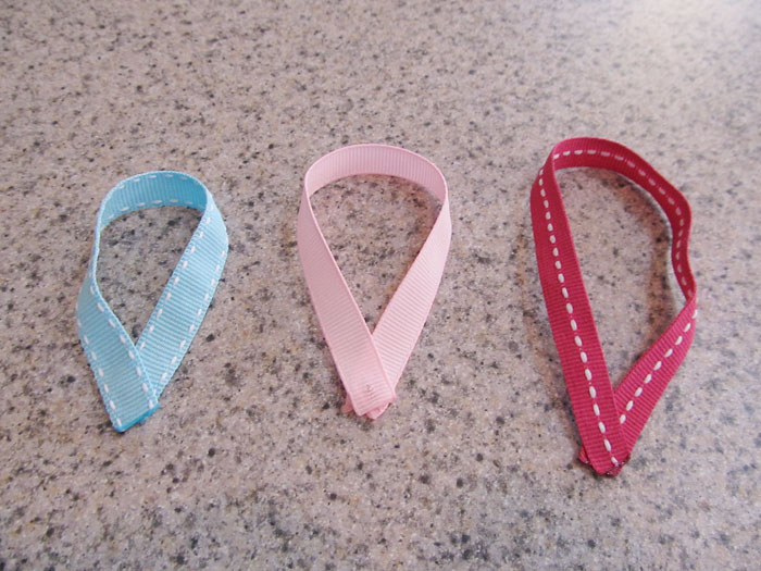 Take the ends of each piece of ribbon, lay the ends on top of each other as shown, and glue to secure.