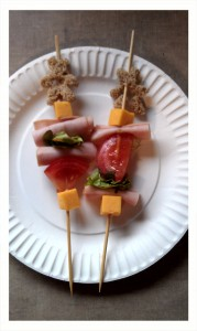 Alternate your sandwich fixin's onto your skewers.  Voila!  Sandwich kebabs!