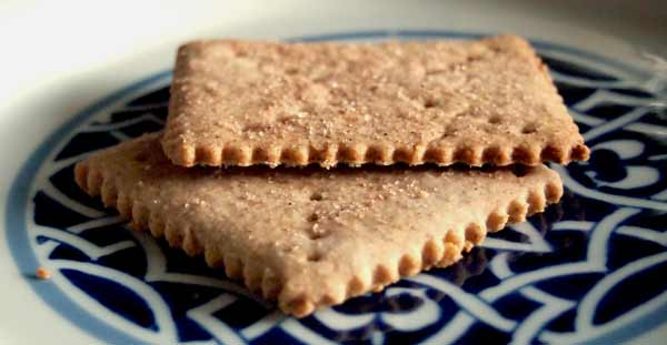 Serving homemade graham crackers, a super healthy kids snack made from whole grains!