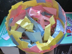I had leftover strips of paper, so crumpling those up work just fine.