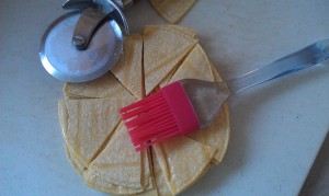 Lightly brush oil onto both sides of the tortillas, stack them and cut into eighths.