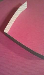Fold each strip of scrapbooking paper in half.