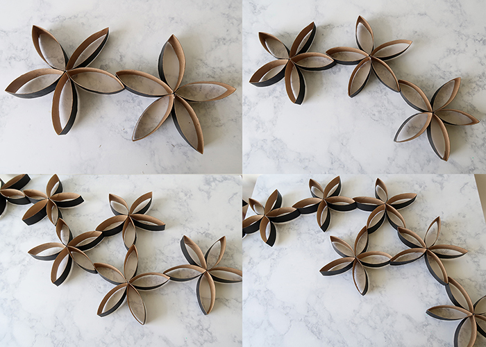 Recycled toilet paper roll flower wall art woo jr kids activities and i just kept adding flowers you can even group three or more together to make little bunches if youre nervous about gluing as you go you can even lay mightylinksfo